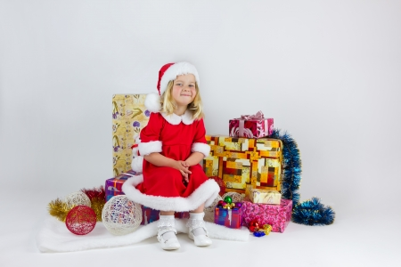 Sweet girl in a red Christmas costume photo
