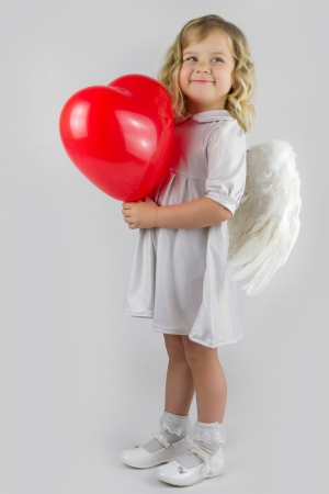 Angel girl with red heart photo
