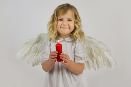 Angel girl with red candle photo