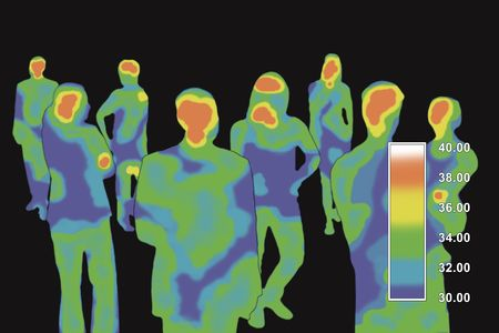 measures: Thermograph reading the body temperatures of a group of people. Stock Photo