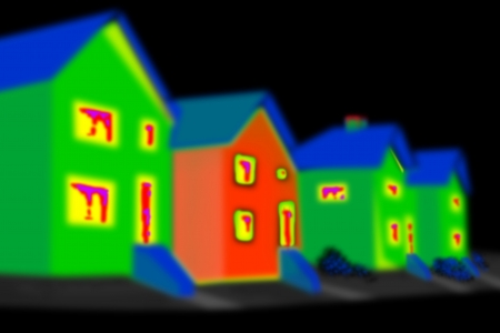 heat radiation: Thermal imaging of a house in a black area.