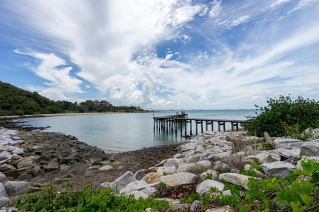 Preview  ?Save to a lightbox?     ?Find Similar Images   ?Share?      Stock Photo:   Long wooden bridge in beautiful tropical island beach with clear sky