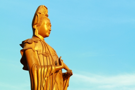 Avalokitesvara with sky background photo