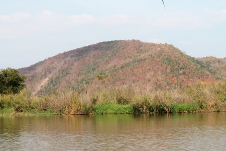 Red mountain on river  photo