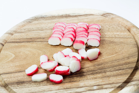 red crab stick on wooden board photo