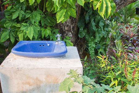 washbasin in forest photo