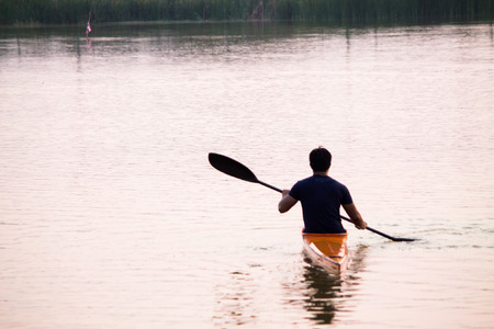 a man rowing in the canoe