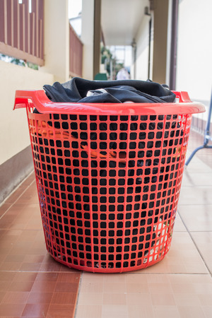 a red laundry basket photo