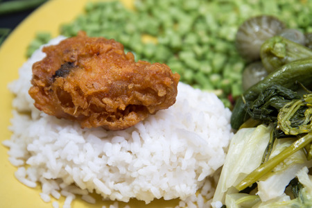 Fried chicken drumsticks and vegetables thai. photo