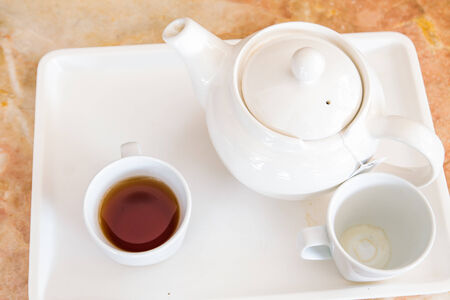 tea cup with teapot photo