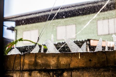 glass on fence dangerous Stock Photo - 31172244