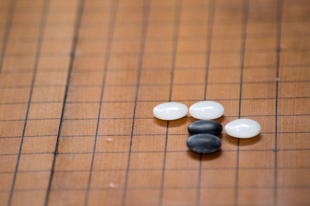 double game: Baduk; Go game black and white stone