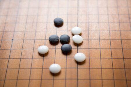 gameplay: Baduk; Go game black and white stone