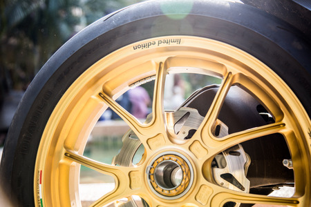 motor cycle: Gloden wheel for motor cycle Stock Photo