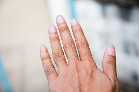 counting five: The hand is a old hand. Stock Photo