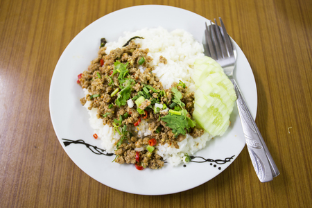 spicy minced meat salad with rice Stock Photo