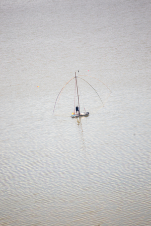 boat is fishing on the river