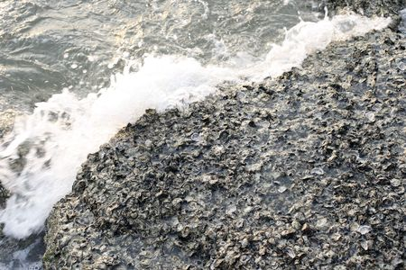 coalesce: Rock and surf Stock Photo