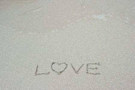 Love letter on sand photo