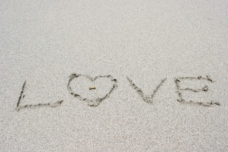 Love letter and ring on sand Stock Photo - 8133292