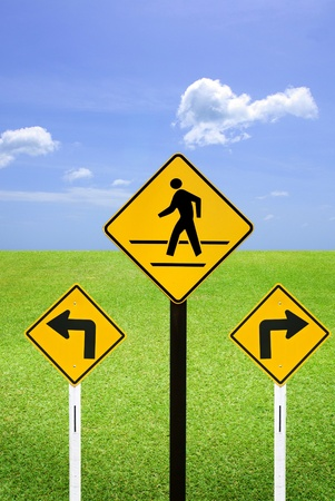 A man walking sign with turn left and turn right sign photo