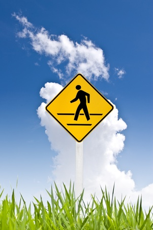 A man walking sign with nice sky Stock Photo - 8418241