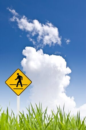 A man walking sign with nice sky