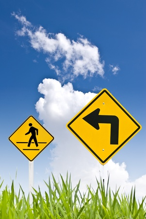 A man walking sign with turn left sign Stock Photo - 8418243