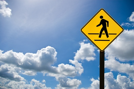 A man walking sign with cloudy sky photo