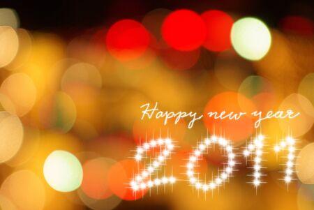 Happy new year 2011yellow lighting background  photo