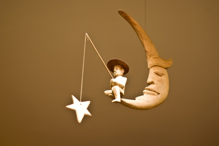 man in the moon: Man fishing the star on the moon, Toy mobile Stock Photo