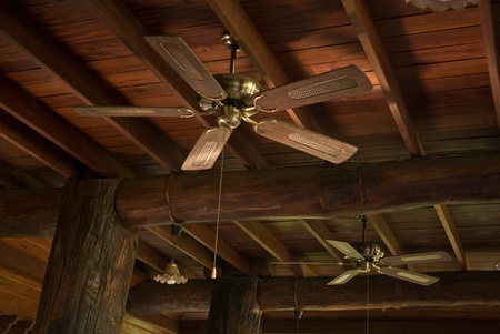 fixed line: Fan hanging on the wooden ceiling