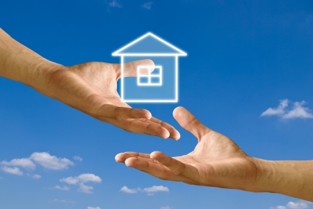 sell: Seller hand send house to buyer hand, Concept Stock Photo