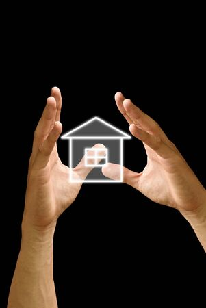 give and take: The hand hold the house icon on black background Stock Photo