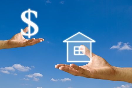 Small hand exchange the Dollar icon  with the house photo