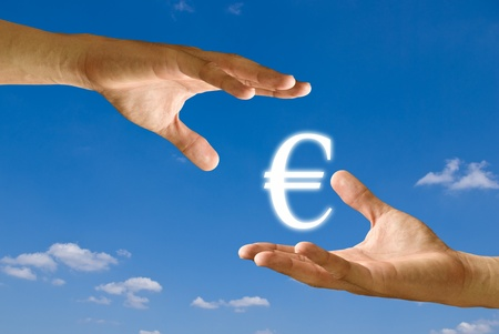 Seller hand take the Euro icon from the buyer hand Stock Photo - 9349015