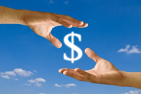barter: Two hands share the Dollar icon together Stock Photo