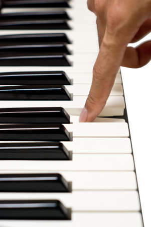 lessons: Artist finger on the Piano key Stock Photo