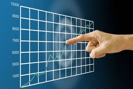Finger push the stock exchange's statistic graph Standard-Bild