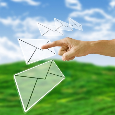 spam mail: Finger pushing the letter with nature background, Email concept Stock Photo