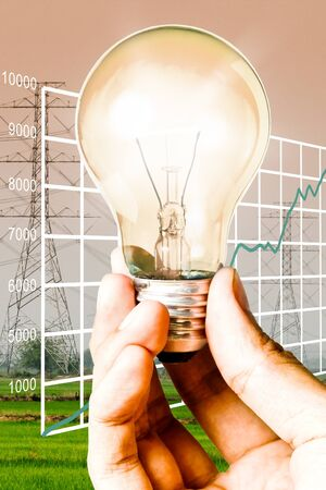 Light bulb in the hand with electricity post background, Save energy and power concept photo