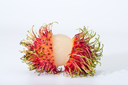 chipped: Chipped Rambutan on white background, Isolated Stock Photo