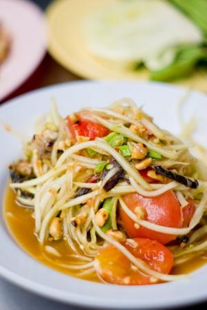 Green papaya salad inside dish, Thai food photo