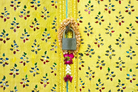 Native Thai style of decorate pattern on door in Buddish temple photo
