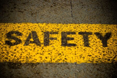 Safety sign words on the metal ground Stock Photo - 10515622