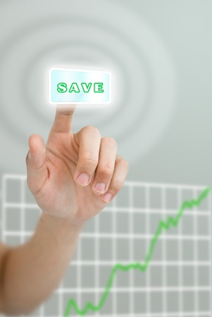 grown up: Hand pushing save button with grown up graph of stock market