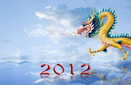 Golden dragon flying over the sea with 2010 year number, New year background photo