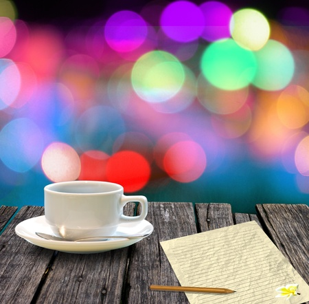 Hot coffee and letter paper on wooden table with colorful bokeh background, Letter concept photo