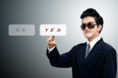Young Asian business man pushed yes button, Business concept Stock Photo - 10866085