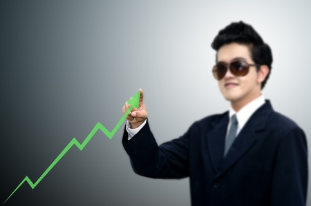 taget: Asian businessman pointed the direction of graph, Stock exchange concept